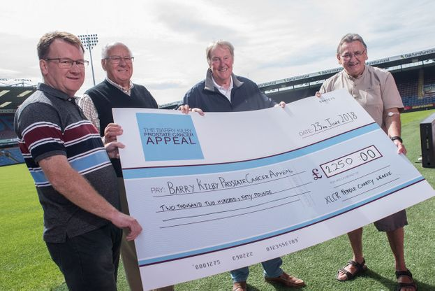 Supports holding a large cheque