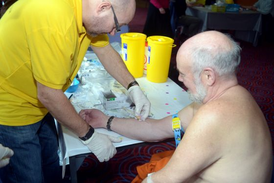 An elderly man at a prostate cancer testing event